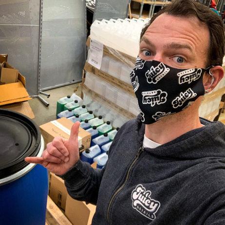 man wearing juicy details branded face mask